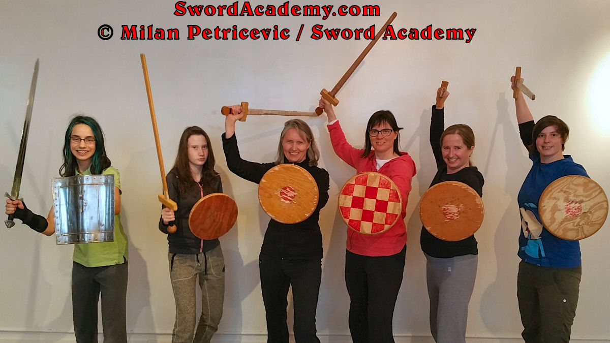 Students pose with swords and bucklers at the end of the Introduction to Medieval Sword and Buckler course inspired by historical sources from German medieval (and renaissance) tradition, part of Sword Academy HEMA / WMA / Martial Arts curriculum.