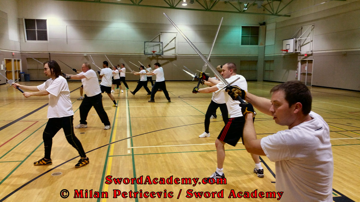 Sword Academy students perform the solo / shadow techniques with longsword / sword inspired by historical sources from the German medieval and renaissance tradition, part of Sword Academy HEMA / WMA / Martial Arts curriculum.