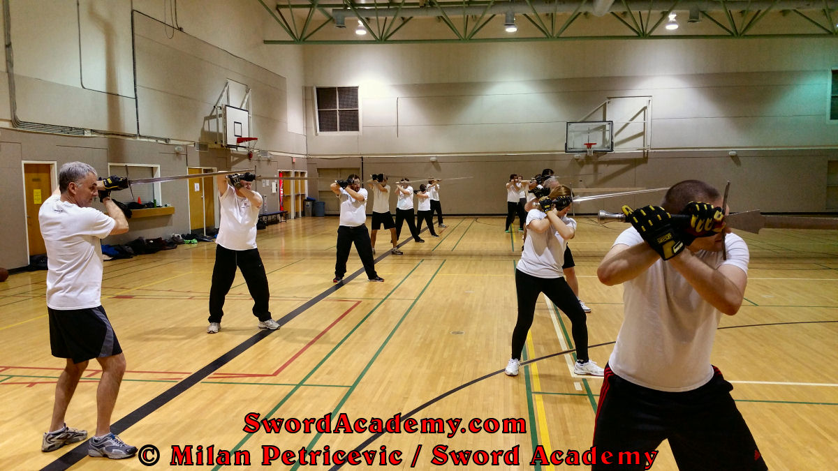 Sword Academy students perform the solo / shadow techniques with longsword / sword from the Ochs guard inspired by historical sources from the German medieval and renaissance tradition, part of Sword Academy HEMA / WMA / Martial Arts curriculum.