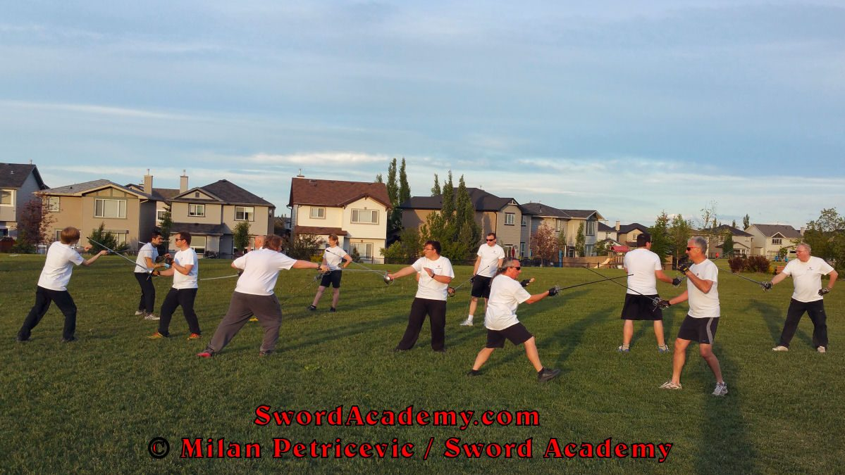Sword Academy students in an outdoor class execute in pairs rapier exercise / drill inspired by historical sources from the Italian renaissance tradition, part of Sword Academy HEMA / WMA / Martial Arts curriculum.