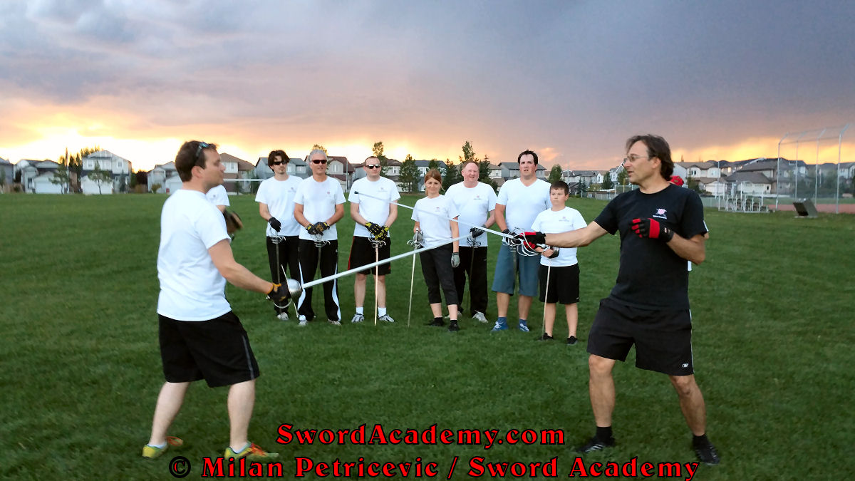 Milan demonstrates during an outdoor class with the inspiring sunset in front of Sword Academy students the rapier exercise / drill using Terza guard inspired by historical sources from the German medieval and renaissance tradition, part of Sword Academy HEMA / WMA / Martial Arts curriculum.