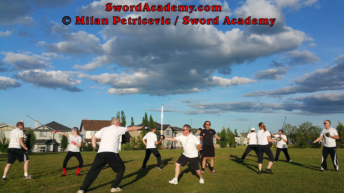 Sword Academy students in an outdoor class under Milan's supervision executes sword / sabre exercise / drill inspired by historical sources from the Croatian, Polish and English tradition, part of Sword Academy HEMA / WMA / Martial Arts curriculum.