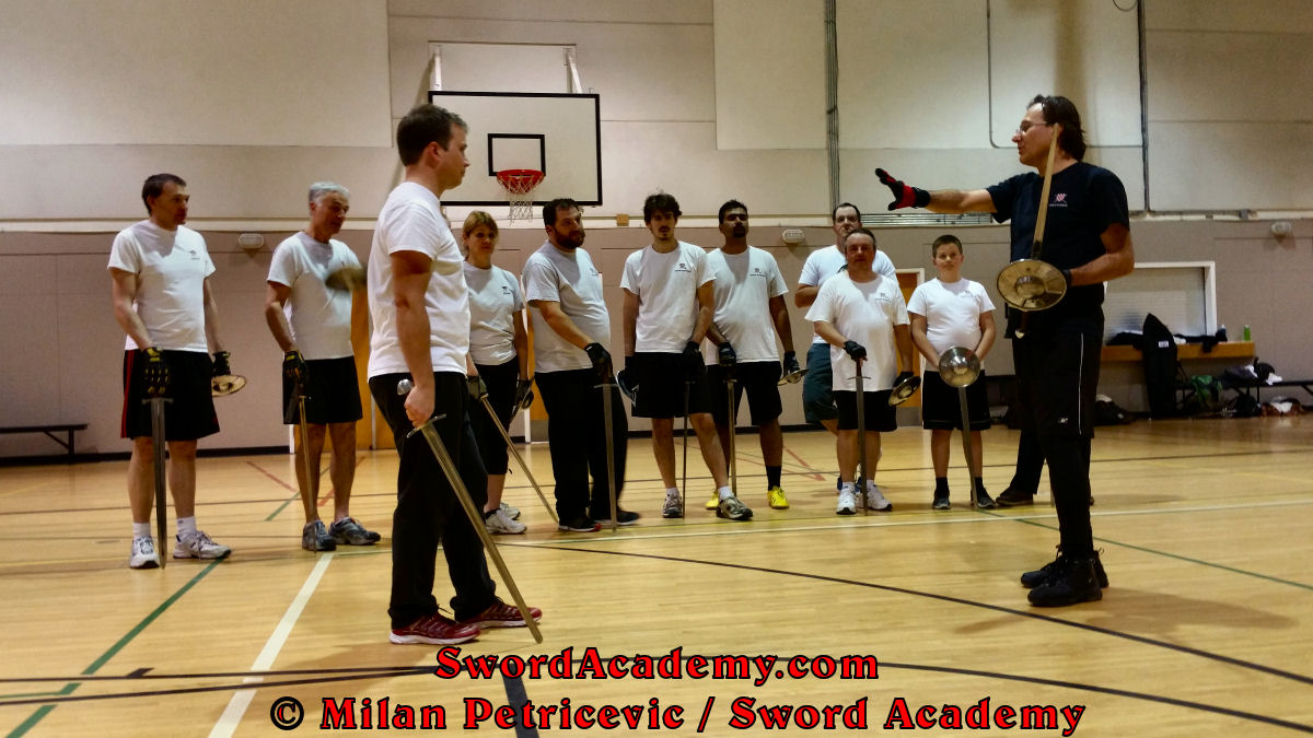 Milan explains the concepts and details of the technique with the sword and buckler to the students in the indoor Sword Academy class session. Based on historical sources from German medieval and renaissance period, part of Sword Academy HEMA / WMA / Martial Arts curriculum.